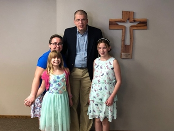 Our pastor and family